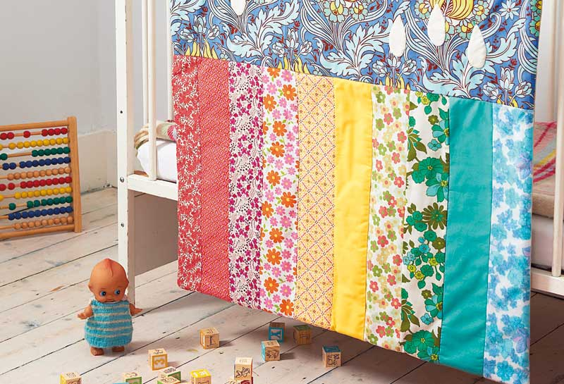 Raindrops and rainbows mini quilt